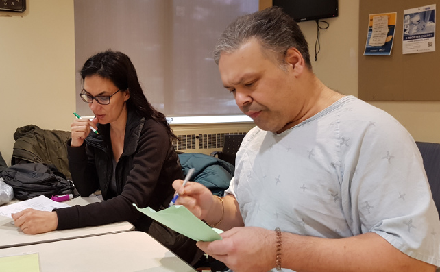 Two people reviewing notes